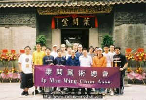 Ip Man Martial Arts Athletic Association takes photo at Ip Man Stage